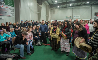 Cooper Nemeth's parents Brent and Gaylene, and sister Kiana are surrounded by community during a smudging ceremony and prayer circle for Cooper Nemeth at Gateway Recreational Centre Monday February 22, 2016.  (David Lipnowski for Metro News)