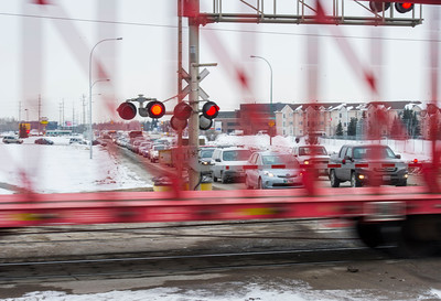 Traffic is backed up at the railway crossing at Waverley Street and Taylor Avenue Wednesday February 24, 2016.  The city of Winnipeg wants to build a multi-million dollar underpass at this location. (David Lipnowski for Metro News)