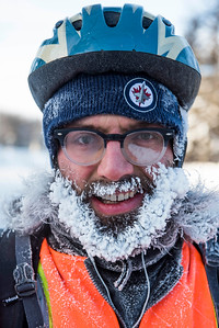 Jason Bekolay and his ice beard cycle to work Wednesday January 4, 2016. (David Lipnowski for Metro News)