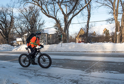 Jason Bekolay cycles to work Wednesday January 4, 2016. (David Lipnowski for Metro News)