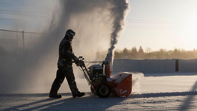 Site Supervisor for Sir John Franklin Community Centre Scott Street snow blows a hockey rink Wednesday January 4, 2016. (David Lipnowski for Metro News)