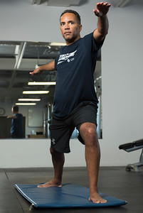 Founder of U-turn Parkinson's, Tim Hague Sr. does a yoga pose Monday July 10, 2017. Tim runs the Winnipeg charity and advocacy group that helps people with Parkinson's disease live well through boxing exercises. Now he's about to launch a special yoga program for the same purpose. (David Lipnowski for Metro News)