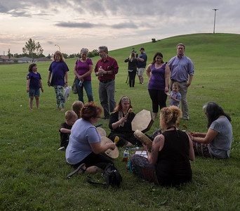Buffalo Gals perform a drum ceremony for friends and family that attended a vigil type event on the one year anniversary of Thelma Krull's disappearance at Civic Park Monday July 11, 2016. (David Lipnowski for Metro News)
