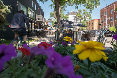People enjoy the patio on Corydon Ave Friday June 10, 2016 (David Lipnowski for Metro News)