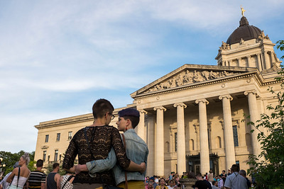 Amy Friesen (left) and Raisal Maxwell (right) during a vigil held by Pride Winnipeg for those murdered in Orlando, Florida Monday June 13, 2016 at the Manitoba Legislature building. (David Lipnowski for Metro News)