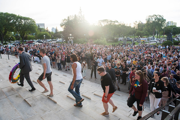 A large crowd attended a vigil held by Pride Winnipeg for those murdered in Orlando, Florida Monday June 13, 2016 at the Manitoba Legislature building. (David Lipnowski for Metro News)