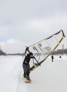 Dave Johnson competes in the first Winter Wind Derby on a handmade flying contraption Saturday March 5, 2016 on the Red River Mutual Trail at the Forks. (David Lipnowski for Metro News)