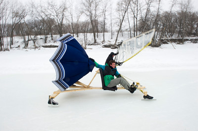 Simon Jones is neck in neck with Dave Johnson as they compete in the first Winter Wind Derby on a handmade flying contraption Saturday March 5, 2016 on the Red River Mutual Trail at the Forks. (David Lipnowski for Metro News)