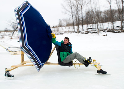 Simon Jones competes in the first Winter Wind Derby on a handmade flying contraption Saturday March 5, 2016 on the Red River Mutual Trail at the Forks. (David Lipnowski for Metro News)
