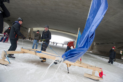 The HMCS Windpassing gets a once over before competing in the first Winter Wind Derby on a handmade flying contraption Saturday March 5, 2016 on the Red River Mutual Trail at the Forks. (David Lipnowski for Metro News)