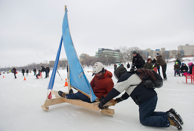 The Admiral also known as Chris Pancoe gets a push as he competes in the first Winter Wind Derby on a handmade flying contraption Saturday March 5, 2016 on the Red River Mutual Trail at the Forks. (David Lipnowski for Metro News)