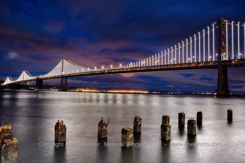Bay Bridge Lights Winter Night with Pilings