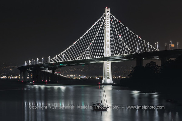 Silvery Eastern Span of Bay Bridge with Sailboat