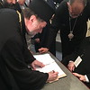 Metropolitan Nicholas signing the documents at the Holy & Great Council of June 2016