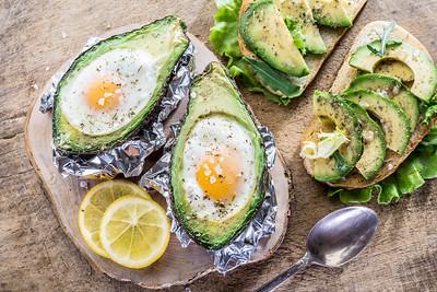 Avocado sandwich and chiсken egg baked in avocado.