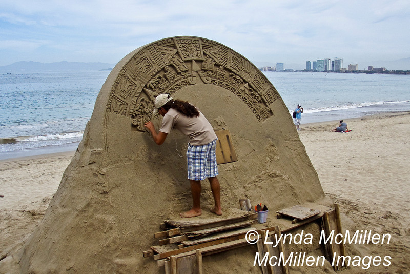 Sandcastle artist along the Malecon, old town Puerto Vallarta.