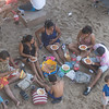 Mexican Family Picnic on the Beach below the bridge over the Malecon