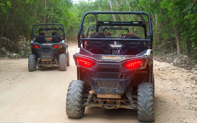 Riding ATVs on a jungle track.