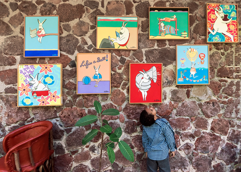 Young art lover admiring the paintings, Yves Restaurant, Ajijic, Mexico
