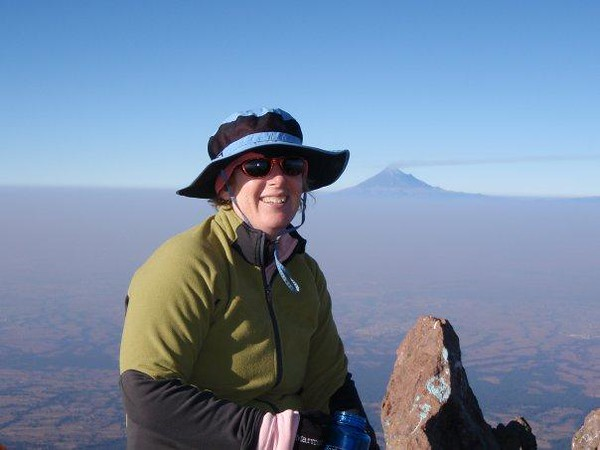 That's me on the top of La Malinche  - I look like hell, but that's after a few days on the road in Mexico.  By the time I got to Puebla I was done, so no Orizaba for me on this trip.  Maybe next year.  Well, I only got about 100' higher than I'd ever been before (14600'), so not such a great accomplishment.  Climbing La Malinche is about like climbing Mount Elbert in Colorado.  That's Popo in the background.