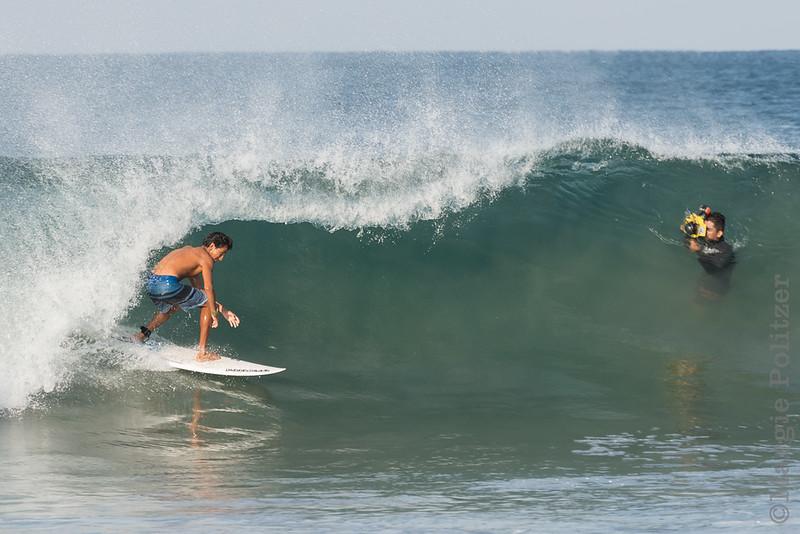 Surfer and photographer at Zicatela Beach, Puerto Eascondido