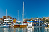 The marina with pleasure boats and lighthouse at Cabo San Lucas, Baja California Sur, Mexico.