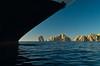 A cruise ship bow and off shore rocks at Lands End near Cabo San Lucas, Baja California Sur, Mexico.
