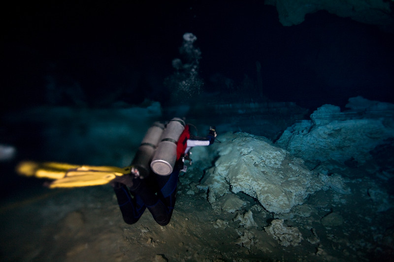The dive master lights the halocline boundary.