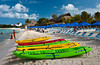 Colorful kayaks on the beach in Cozumel, Mexico.