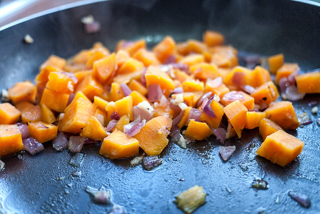 Saute the onions and cook sweet potatoes