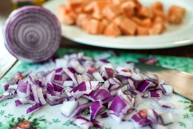 Diced onions and cubed sweet potatoes.