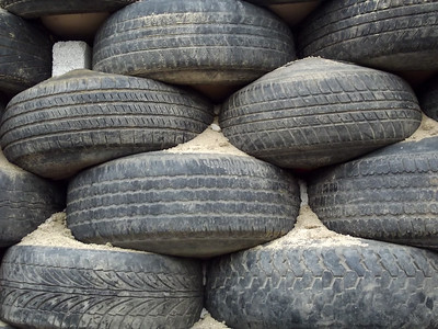 Rows of Old Tires being Used as Building Material