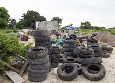 Piles of Used Tires at Construction Site for a Hybrid Home