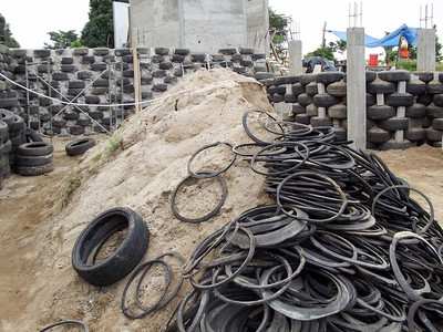 Sand Heap and Pile of Tire Rims