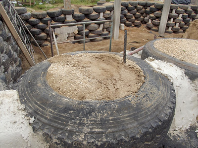 Tire with Compacted Sand Inside Becomes Building Material