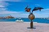 The Mermaid and Dolphin sculpture along the Malecon boardwalk in La Paz, Baja California Sur, Mexico.