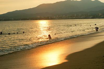 Golden Sunset Reflections on Beach