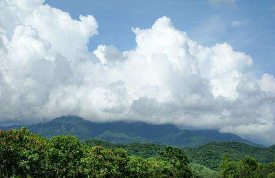 Huge Clouds, Mountain, and Mango Trees