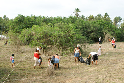 Mexican Volunteers Clear Field by Beach of Litter