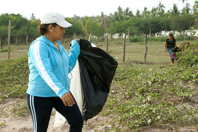 Woman with Black Garbage Bag for Collecting Litter