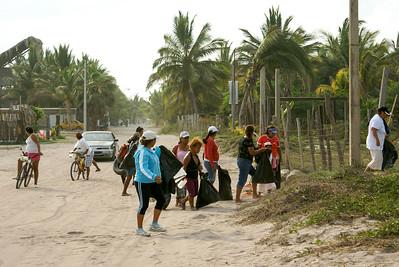 San Blas Garbage Cleanup Volunteers Entering Litter-Filled Field