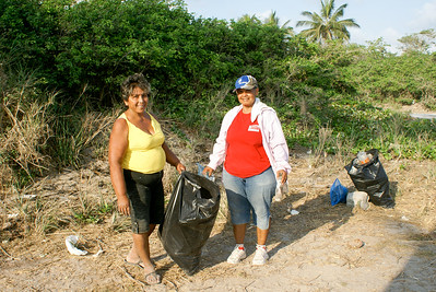 Two Mexican Women Cleaning up Litter