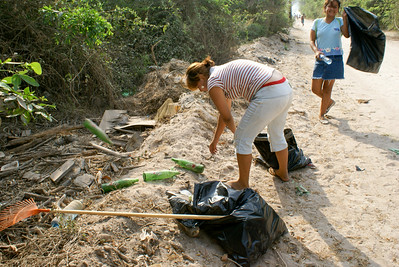 Woman and Girl Cleaning Garbage from Roadside, Mexico