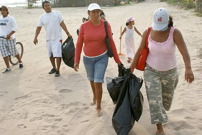 Environmental Cleanup Volunteers with Bags to Collect Litter