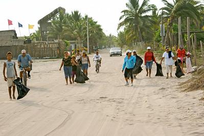 San Blas Litter Cleanup Volunteers Walking on Beach Road