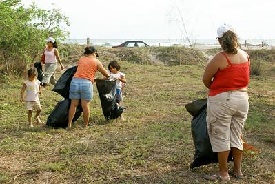 Children Helping Adults Clean Beach Area, San Blas, 2009