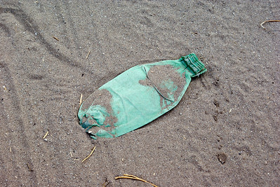 Flattened Green Plastic Bottle Litter