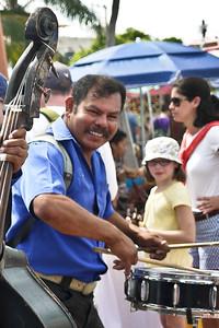 Grinning Mariachi drummer at La Penita market.