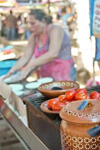 Fresh street food from a taco stand at La Penita market.