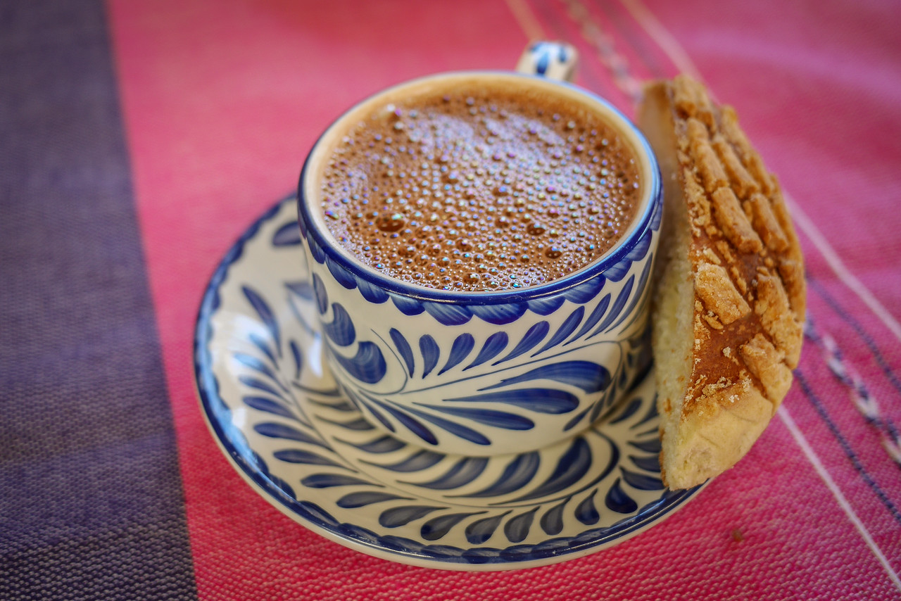 Traditional Mexican hot chocolate with bread for breakfast